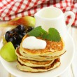 Stock Photo: Homemade pancakes with fruit and yogurt - healthy breakfast