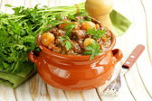 Beef stew with vegetables and herbs in a clay pot - comfort food — Stock Photo