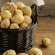 Stock Photo: Fresh organic potatoes on a wooden background, rustic style