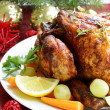 Baked chicken for Christmas dinner, festive table setting — Stock Photo