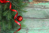 Christmas composition with fir twigs and decorations — Stock Photo