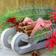 Christmas composition - wooden sleigh with gifts and fir tree branches — Stock Photo