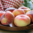 Fig peaches sweet and ripe on a wooden table — Stock Photo