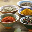 Different kinds of spices in ceramic bowls — Stock Photo #31340471