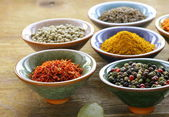 Different kinds of spices in ceramic bowls — Stock Photo