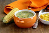 Soup of fresh yellow corn served on a wooden table — Stock Photo
