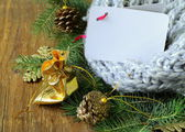 Christmas composition with a knitted scarf and decorations — Stockfoto