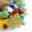 Christmas decorations (balls, cones, stars) in the yellow box — Stock Photo