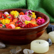 Wooden bowl with roses and petals of flowers - spa concept — Stock Photo