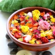 Wooden bowl with roses and petals of flowers - spa concept — Stock Photo #31881933