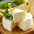Soft brie cheese (camembert) with pears on a wooden board — Stock Photo