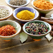 Different kinds of spices in ceramic bowls — Stock Photo #31989135