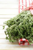 Bunch of fresh fragrant thyme on a wooden background — Stock Photo