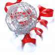 Silver Christmas ball (decoration) with a red ribbon — Stock Photo