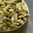 Macro shot fennel seeds, aromatic spice seasoning — Stock Photo