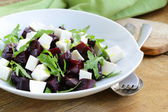 Salad with beetroot and soft feta cheese and arugula — Stock Photo