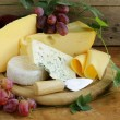 Cheeseboard (Maasdam, Roquefort, Camembert) and grapes for dessert — Stock Photo #32784981