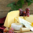 Cheeseboard (Maasdam, Roquefort, Camembert) and grapes for dessert — Stock Photo #32903989