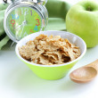 Healthy breakfast - muesli and apple (alarm clock in the background) — Stock Photo
