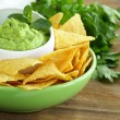 Cup with guacamole and corn chips - traditional Mexican appetizer — Stock Photo #33294069