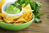 Cup with guacamole and corn chips - traditional Mexican appetizer — Stock Photo