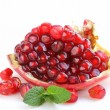 Red juicy ripe organic pomegranate fruit — Stock Photo