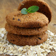Pile of round oatmeal cookies with dry oatmeal — Stock Photo