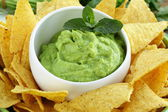 Cup with guacamole and corn chips — Stock Photo