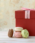 French multicolored macaroons on a vintage background — Stock Photo