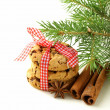 Christmas cookies with red ribbon and green fir tree  branches — Stock Photo
