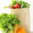 Set of different convenience food (vegetables fruit) in a paper bag — Stock Photo