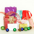 Many gift boxes and colorful shopping bags on white background — Stok fotoğraf #33771407