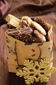 Variety of cookies with chocolate and almonds in a gift package — Stock Photo