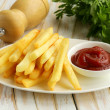Traditional French fries with tomato ketchup — Stock Photo #34200823