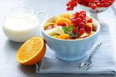 Fruit salad with orange — Stock Photo
