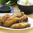 Fried chicken wings with spicy sauce in asian style — Stock Photo