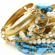 Gold, turquoise jewelry and pearl,  on a white background — Stock Photo
