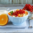 Foto Stock: Fruit salad with orange