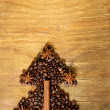 Christmas tree stylistic symbol of the coffee bean, cinnamon and star anise — Stock Photo