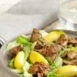 Gourmet salad with a roasted chicken liver and apple — Stock Photo