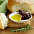 Still life in the Italian style - ciabatta bread, olive and oil — Stock Photo