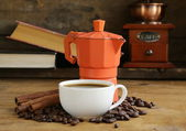 Coffee maker, beans and cup of espresso — Stock Photo