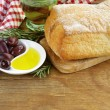 Still life in the Italian style - ciabatta bread, olive and oil — Stockfoto