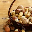 Assortment of different nuts (peanuts, hazelnuts, pistachios, walnuts) — Stock Photo