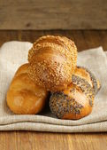 Assortment bread (rye, white long loaf, whole-grain cereal bun) — Stock Photo