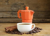 Coffee beans, coffee pot and cup of espresso — Stock Photo