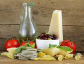 Still life of Italian foods ( olive, oil, pasta, cheese ) — Stockfoto