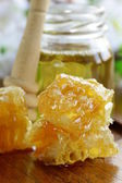 Natural organic honey in the comb and glass jar — Stock Photo
