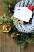 Christmas composition with a knitted scarf and decorations — Stock Photo