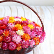 Wicker basket with multicolored flowers — Stock Photo